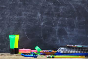 School supplies on a wooden desk