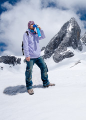 Climber breathing with mini portable oxygen to avoid and treat Altitude Sickness