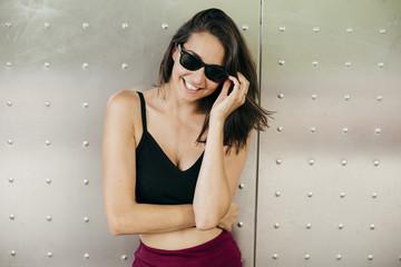 Woman putting on sunglasses