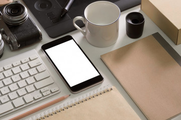 Designer desk mockup. Desk, Camera - Photographic Equipment, Smart Phone, mug on white top table.