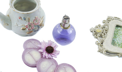 Perfume bottles with white rose flowers on light background. fragrance cosmetics, fragrance collection. Free space for text. Purple concept