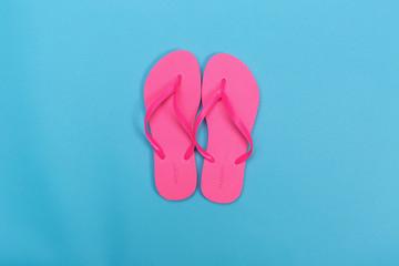 Beach sandals on a blue background