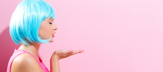 Wall Mural - Portrait of a woman in a bright blue wig
