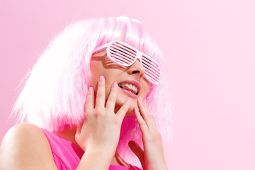 Wall Mural - Beautiful woman in a bright pink wig