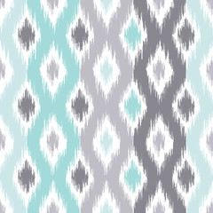 Seamless geometric pattern, based on ikat fabric style. Vector illustration. Carpet rug texture vector imitation. Turquoise mint and grey ogee pattern.