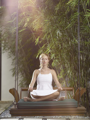 woman meditates on swing