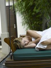 woman sleeping on swing photo