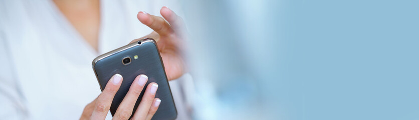Closeup of woman' s hand using smartphone, template