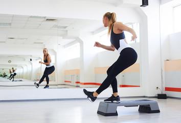 Athlete having a step aerobics in a gym