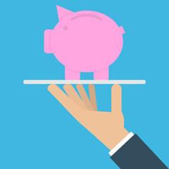 Hand holding piggy bank on a platter