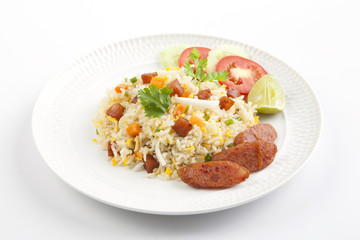 Fried rice with chinese sausage on white plate