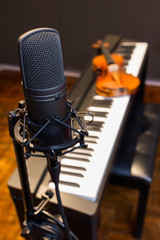 condenser microphone on piano & violin background