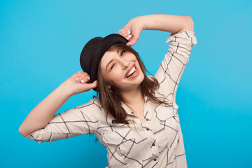Laughing woman posing in hat