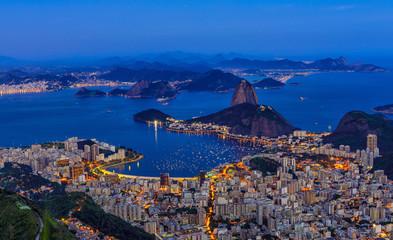 Night view of mountain Sugar Loaf and Botafogo in Rio de Janeiro. Brazil