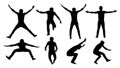Set of black vector silhouettes of jumping or falling man isolated on white background