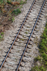 Railway track on gray gravel substrate