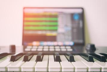 Music keyboard with Computer running DAW music production program.