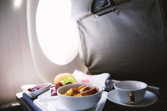 Food served on board of business class airplane on the table