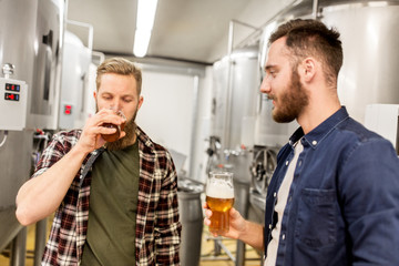 men drinking and testing craft beer at brewery