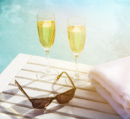 Romantic summer with sparkling drink at the pool.