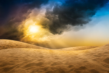 Desert sand with storm cloud