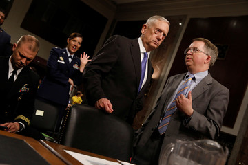 U.S. Defense Secretary Mattis listens to Undersecretary Norquist ahead of testifying before the Senate Armed Services Committee on Capitol Hill in Washington