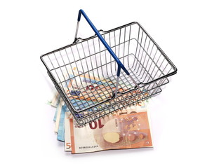 Shopping basket with euro bank notes, bills isolated on white background