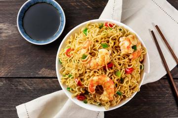 Instant noodles with vegetables and shrimps, plus copyspace