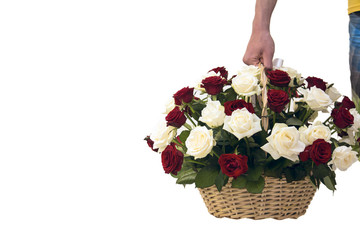 Bouquet of roses in a wooden basket