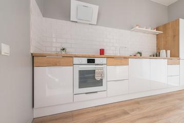 Modern bright kitchen with white furniture