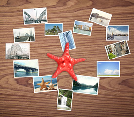 Heart of photos from different places around world and starfish on wooden background. Concept of travel memories