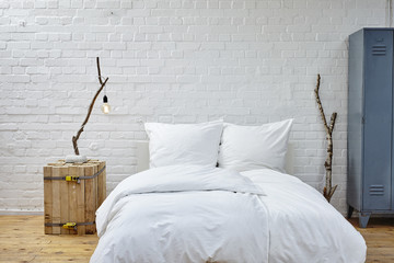 loft atmosphere bedroom white linen and birch branches