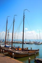 Moody shots of boats tied alongside the moorings at Volendam, Holland