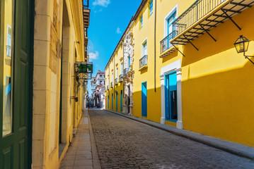 Cuba, Havana, Street with yellow houses