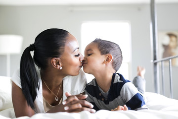 Mother kissing son (2-3)