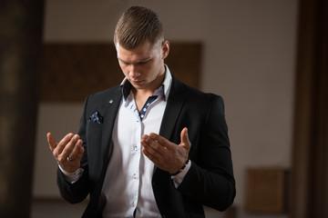 Young Businessman Muslim Praying