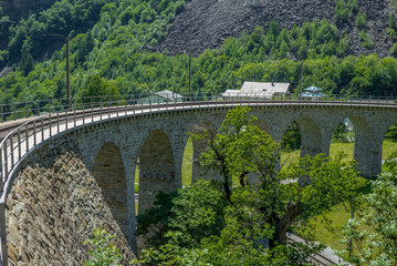 Circular viaduct bridge near Brusio on the Swiss Alps - 6