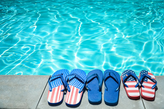 Summer background with flip flops near the pool