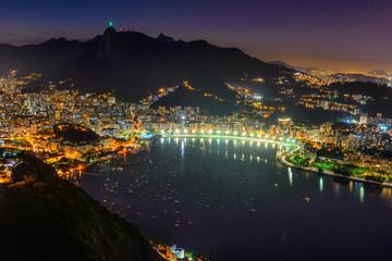 Night view of Corcovado, Botafogo, and Guanabara bay in Rio de Janeiro. Brazil