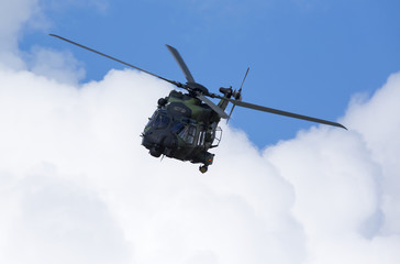 Modern tactical helicopter flying towards.