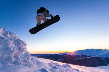 Fototapete - Beautiful sunny day in the mountains, winter, boarder jumping