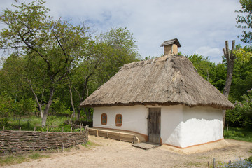 Traditional ukrainian old house with straw roof Wall mural