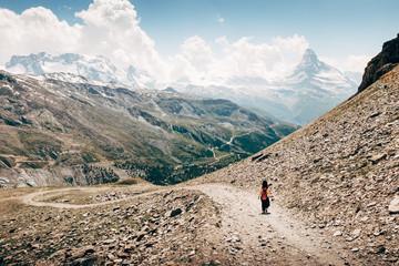 Rear View Of Woman Hiking At Zermatt