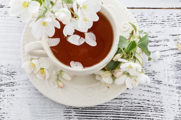 Romantic tea in the blossoming garden
