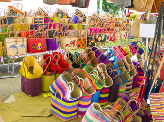 Colorful straw bags at a market in Provence France Souvenirs