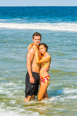 Young American Couple traveling, relaxing on the beach in New Jersey, USA