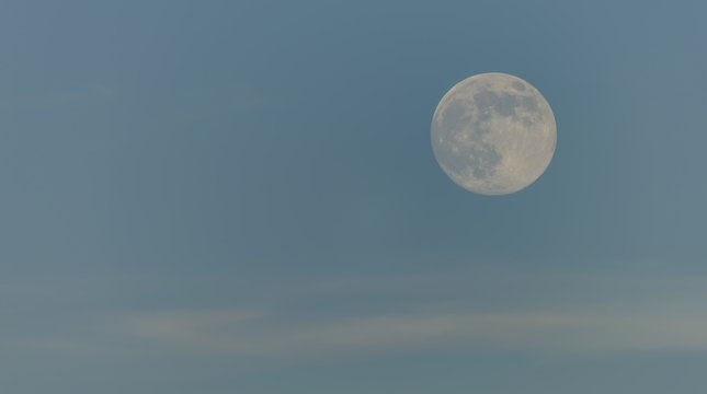 Day moon with light blue sky
