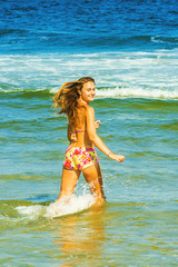 Happy Young Woman Wading on Water.
