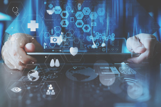 smart doctor hand working with modern laptop computer in modern office with virtual icon diagram