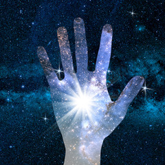 conceptual image of hand and universe